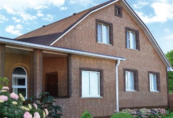 Фасадная отделка домов панелями под камень