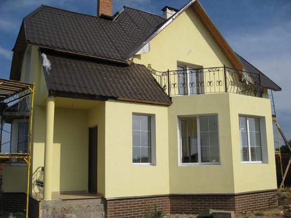 Варианты отделки фасада дома из газобетона штукатурками