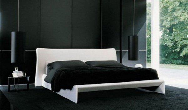 Белая кровать на чистом чёрном фоне