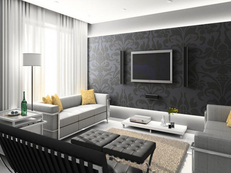 Черные обои подчеркивают минимализм комнаты.