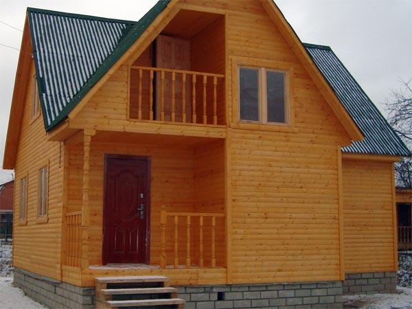 Дом облицованный вагонкой