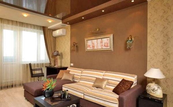 Использование светло-коричневых полотен в интерьере гостиной
