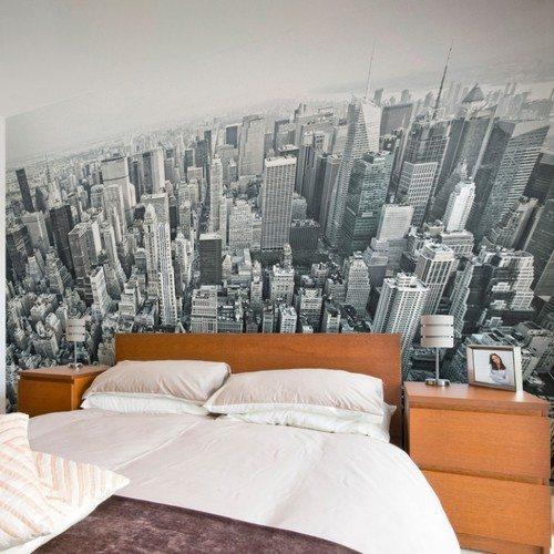 На фото - оформление стены панорамным видом из окна небоскрёба