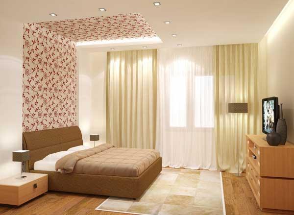 На фото - пример обособления спального места посредством более темных отделочных материалов