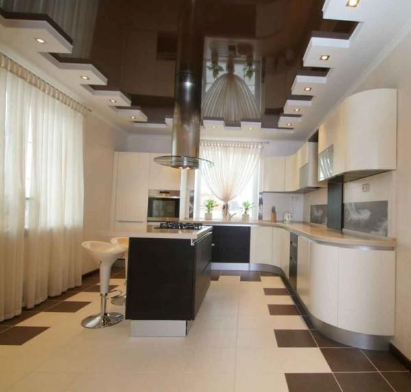 На фото комбинирование гипсокартонных конструкций и натяжного потолка