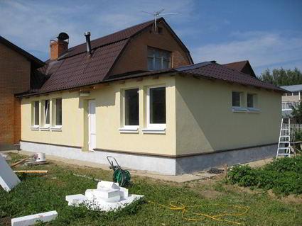 Окрашенный фасад из ориентировано-стружечных плит