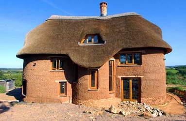 Отделанный дом из самана