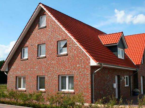 Отделанный клинкерной плиткой фасад