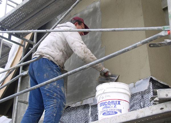 Отделка фасада цементной штукатуркой