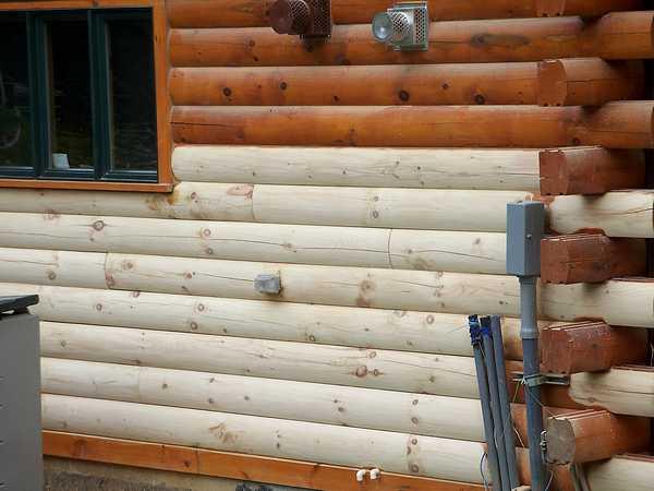 Подготовка фасада деревянного дома.