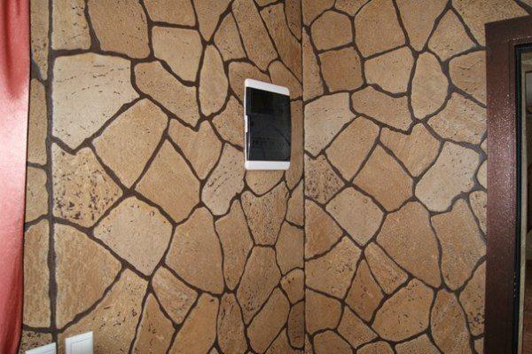 Стены, декорированные под каменную кладку, в интерьере квартиры