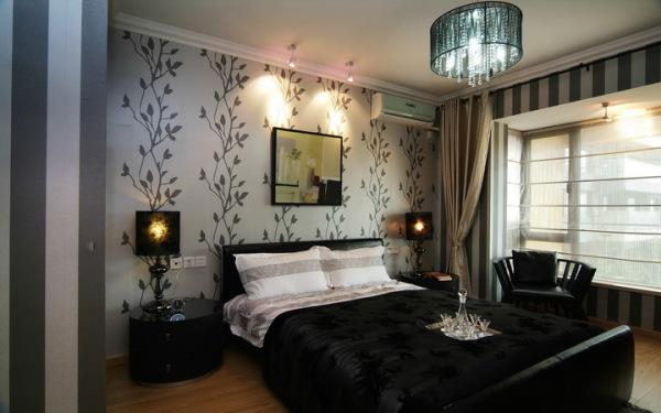 Строгий, но уютный интерьер современной спальни.