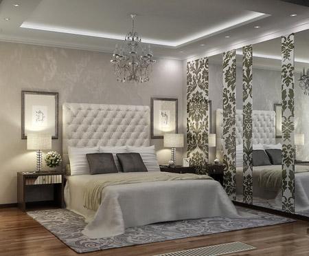 Так смотрится спальня с серыми полотнами на стенах.