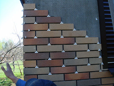 Укладка плитки на фасад.