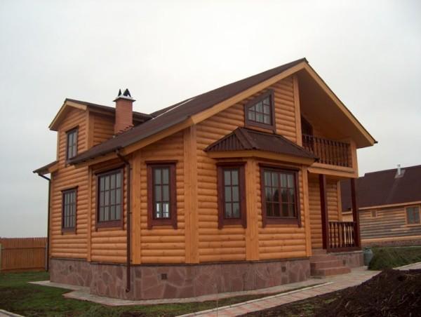 Загородный дом после обшивки блок-хаусом.