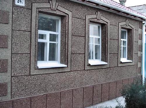 Завершённая отделка дома ЦСП плитой с каменной крошкой